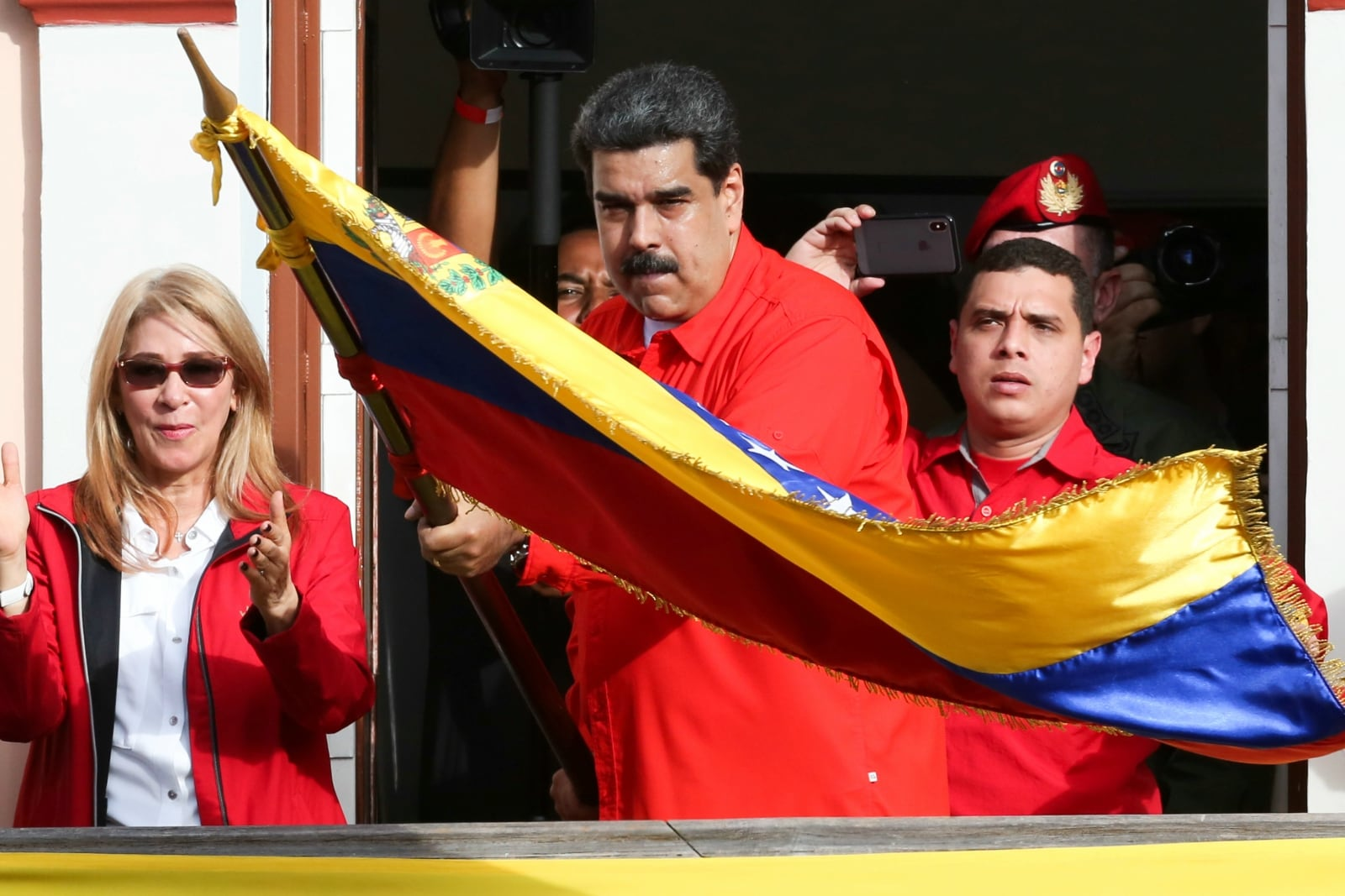 Venezuela's President Nicolas Maduro attends a rally in support of his government and to commemorate the 61st anniversary of the end of the dictatorship of Marcos Perez Jimenez next to his wife Cilia Flores in Caracas, Venezuela January 23, 2019. Miraflores Palace/Handout via REUTERS