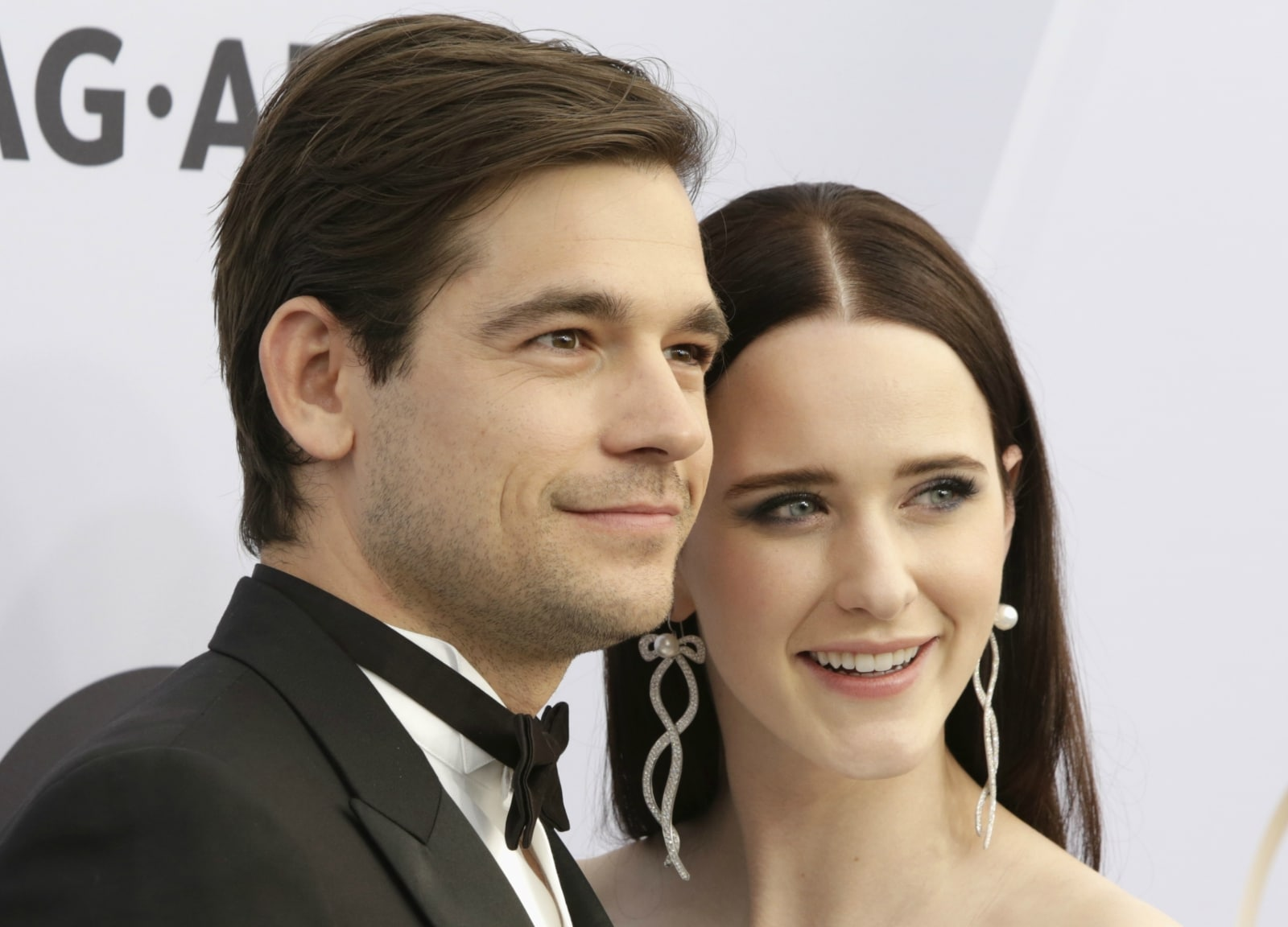 25th Screen Actors Guild Awards – Arrivals – Los Angeles, California, US, January 27, 2019 - Jason Ralph and Rachel Brosnahan pose. REUTERS/Monica Almeida