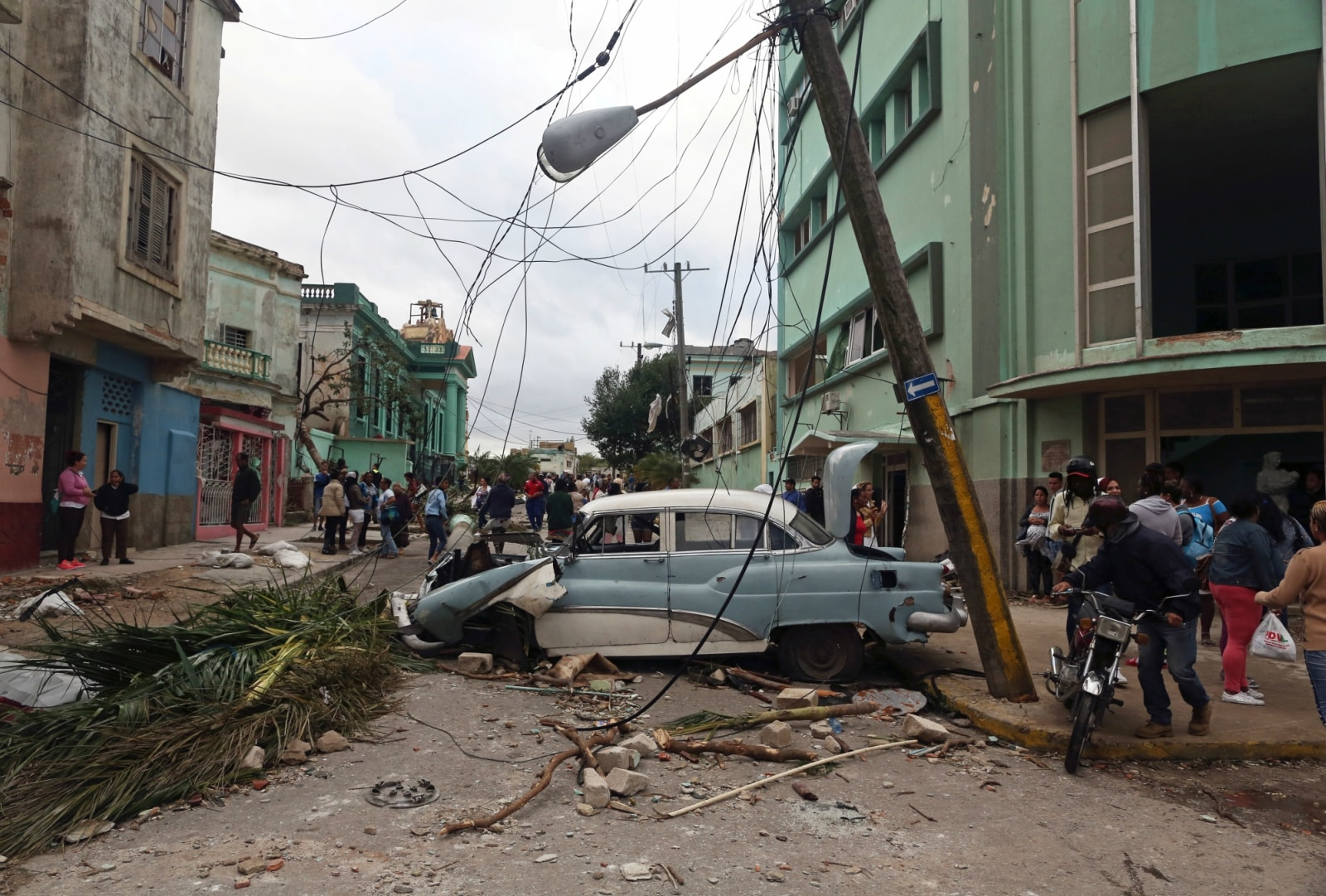 People walk past debris after a tornado ripped through a neighbourhood in Havana, Cuba January 28, 2019. REUTERS/Fernando Medina