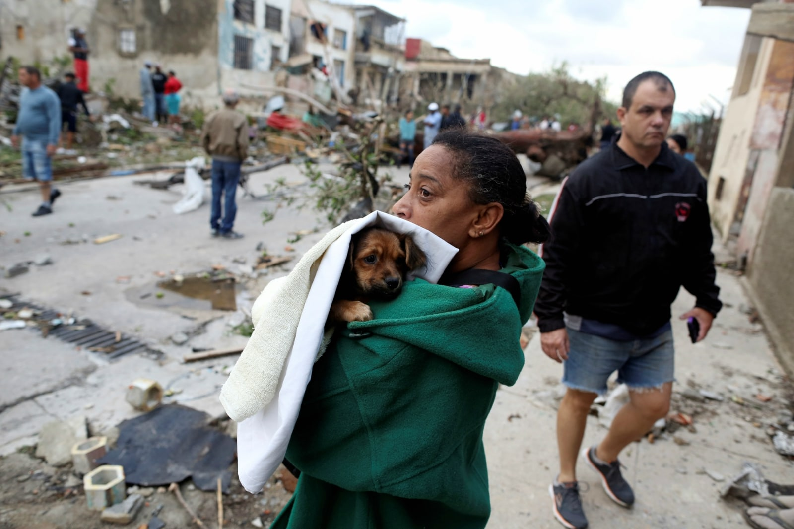 A woman holds her dog after a tornado ripped through a neighbourhood, in Havana, Cuba January 28, 2019. REUTERS/Fernando Medina