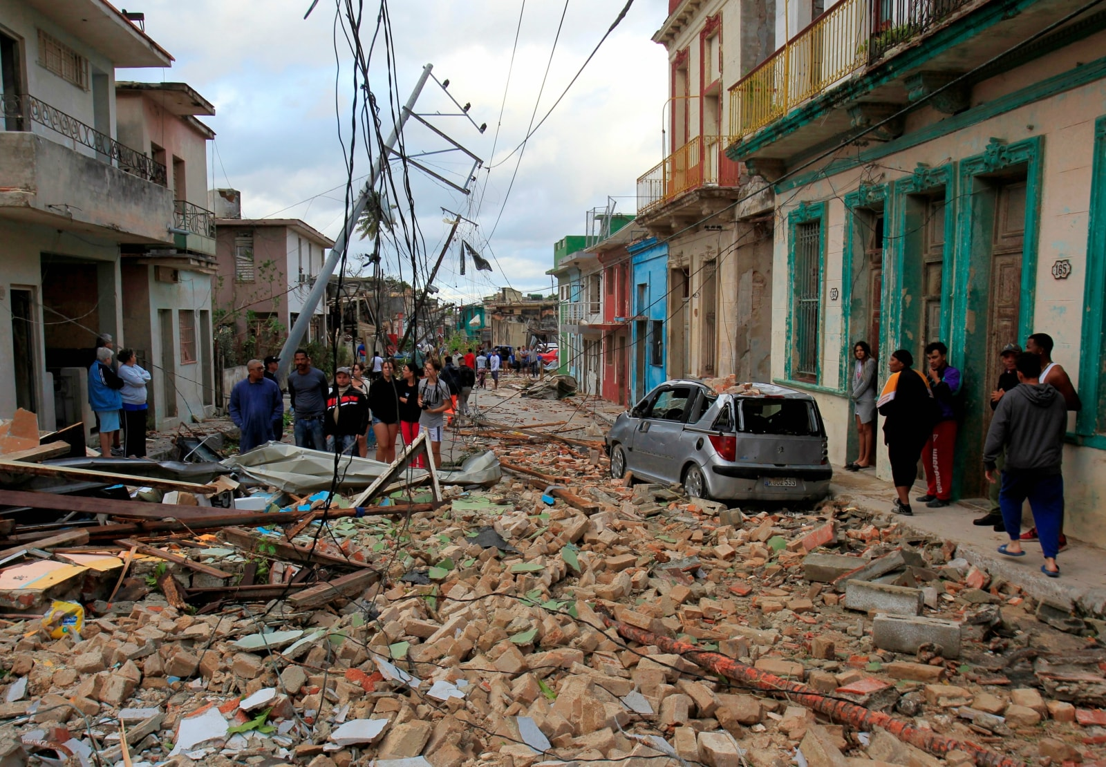 People look on to debris after a tornado ripped through a neighbourhood in Havana, Cuba January 28, 2019. REUTERS/Stringer