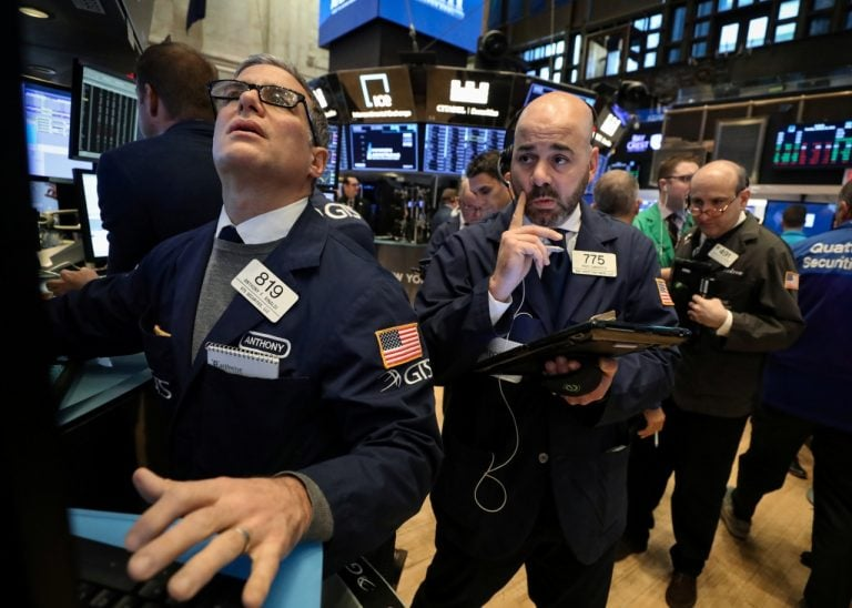 Wall Street edges lower on tech retreat, trade concerns