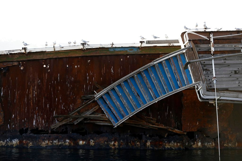 In this Friday, December 4, 2018 photo, seagulls sit on a half sunken cruise ship in the Gulf of Elefsina, west of Athens. (AP Photo/Thanassis Stavrakis)