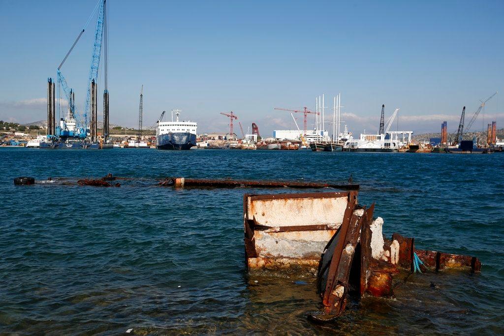 In this Tuesday, November 6, 2018 photo, a half sunken floating platform near a shipyard in Salamina island, west of Athens. (AP Photo/Thanassis Stavrakis)