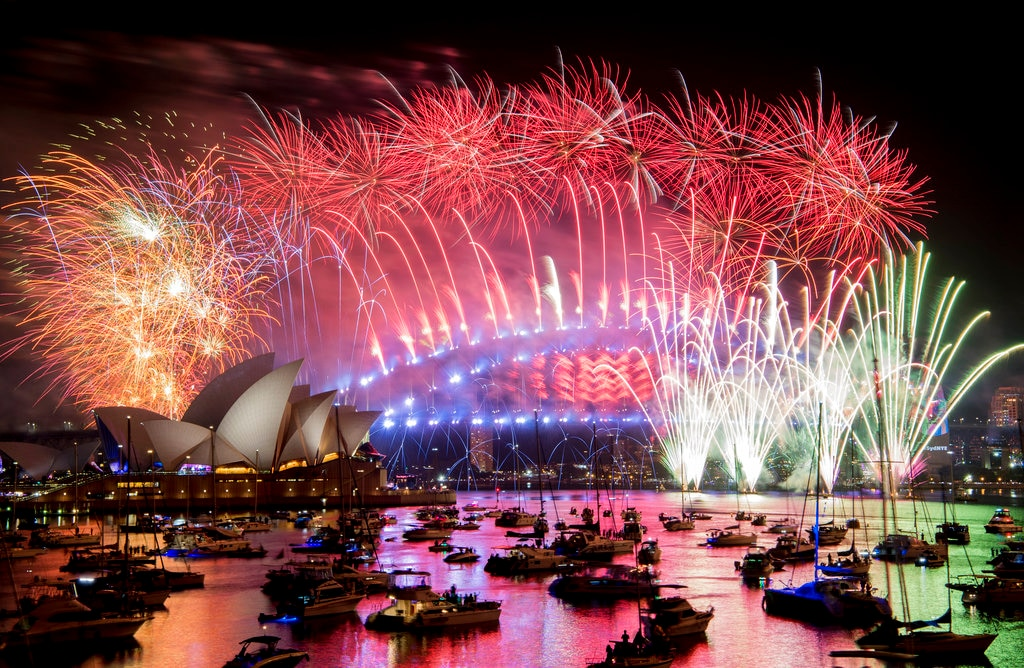Fireworks explode over the Sydney Harbour during New Year's Eve celebrations in Sydney, Tuesday, January 1, 2019. (Brendan Esposito/AAP via AP)