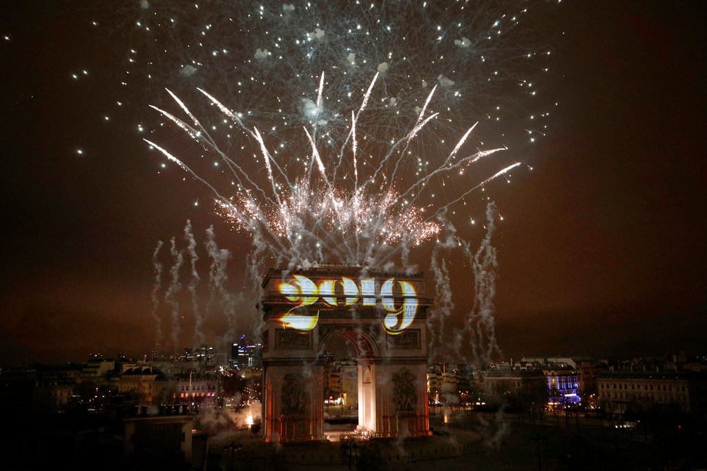 Fireworks explode over the Arc de Triomphe during the New Year's Day celebrations on the Champs Elysees, in Paris, Tuesday,January 1, 2019. (AP Photo/Kamil Zihnioglu)
