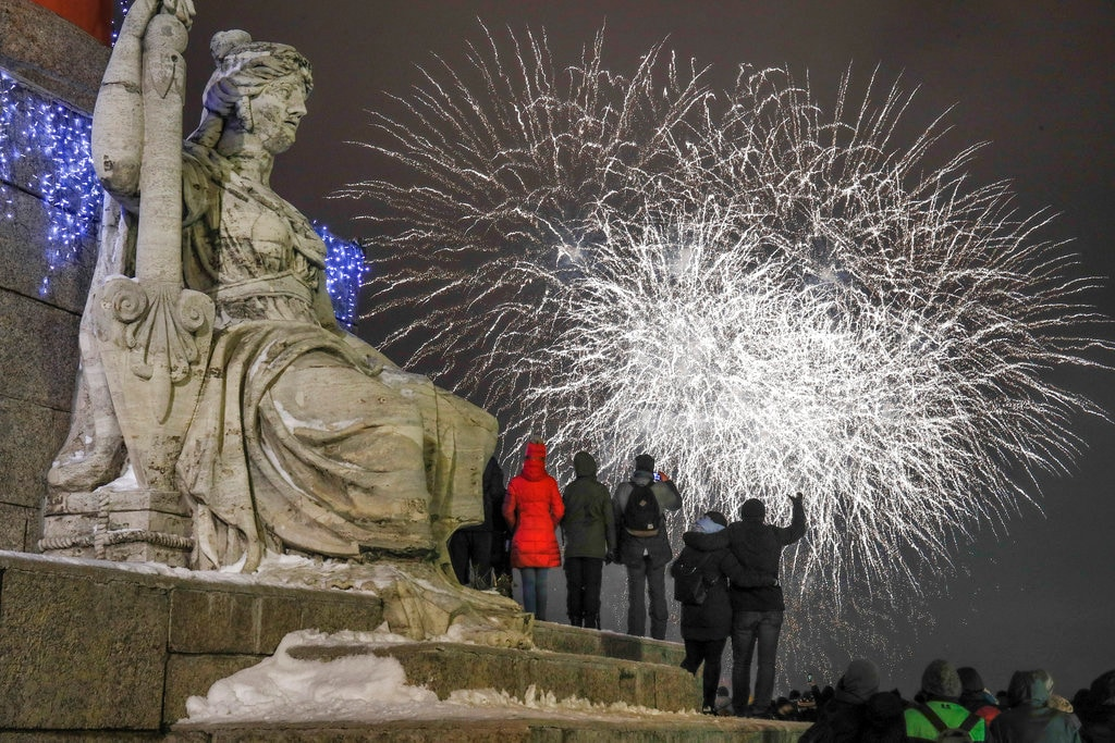People watch fireworks during New Year celebration in downtown St.Petersburg, Russia, Tuesday, January 1, 2019. (AP Photo/Dmitri Lovetsky)