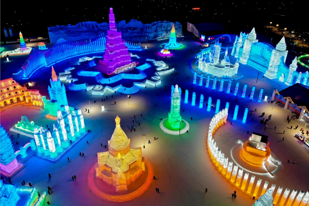An aerial view taken with a drone shows visitors tour colorful structure made from blocks of ice at the Harbin International Ice and Snow festival held in Harbin in northeastern's China's Heilongjiang province, Friday, January 4, 2019. (AP Photo/Olivia Zhang)