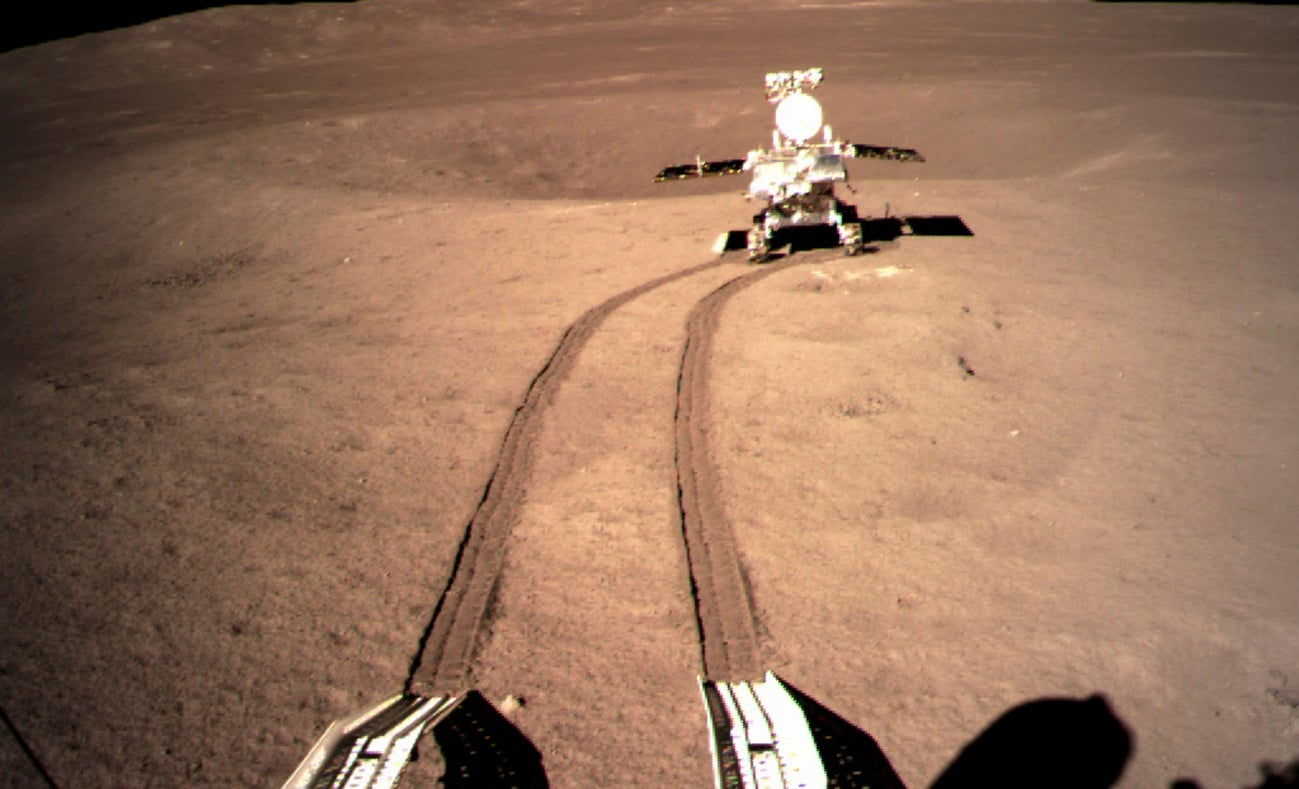 China's lunar rover, leaves wheel marks after leaving the lander that touched down on the surface of the far side of the moon. (China National Space Administration/Xinhua News Agency via AP, File)