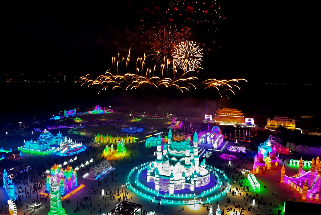 An aerial view shows fireworks explode over ice sculptures during the opening of the annual Harbin International Ice and Snow Festival in Harbin in northeast China's Heilongjiang province, Saturday, January 5, 2019. (AP Photo/Olivia Zhang)
