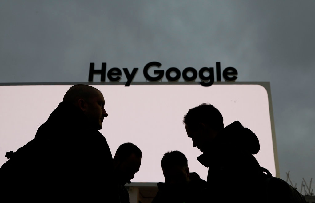 People stand in front of the Google tent during preparations for CES International in Las Vegas. (AP Photo/John Locher).