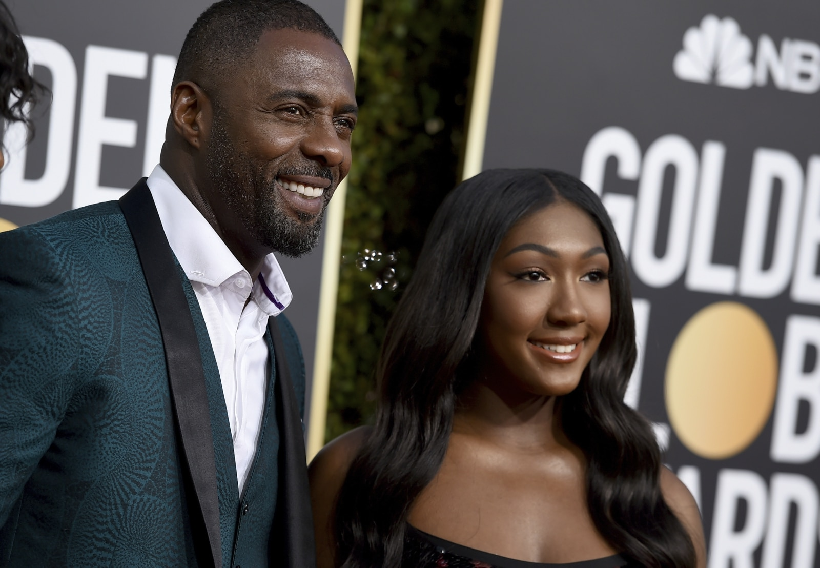 Idris Elba, left, and his daughter Isan Elba arrive at the 76th annual Golden Globe Awards at the Beverly Hilton Hotel on Sunday, January 6, 2019, in Beverly Hills, California<strong>.</strong> (Photo by Jordan Strauss/Invision/AP)