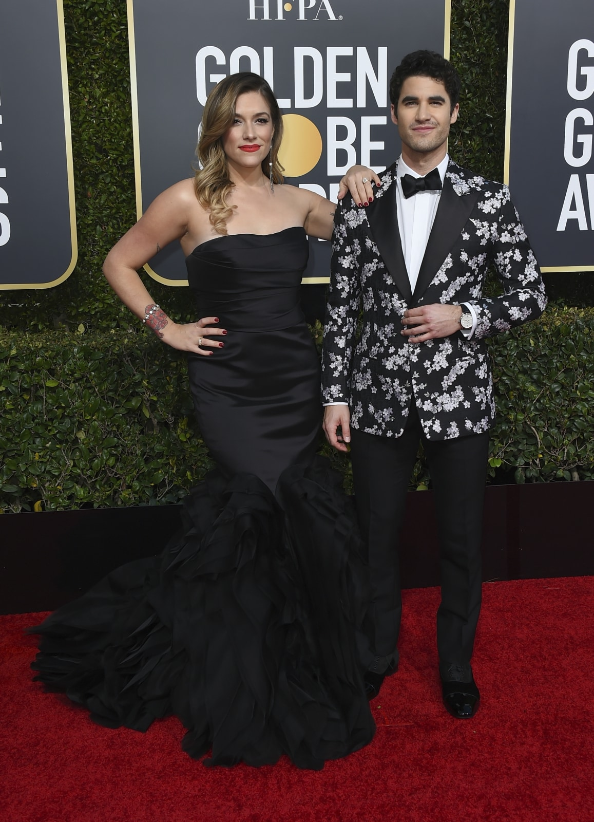 Mia Swier, left, and Darren Criss arrive at the 76th annual Golden Globe Awards at the Beverly Hilton Hotel on Sunday, January 6, 2019, in Beverly Hills, California. (Photo by Jordan Strauss/Invision/AP)