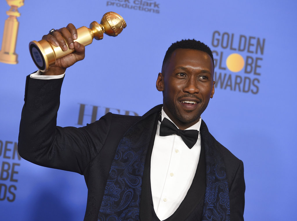 Mahershala Ali poses in the press room with the award for best performance by an actor in a supporting role in any motion picture for