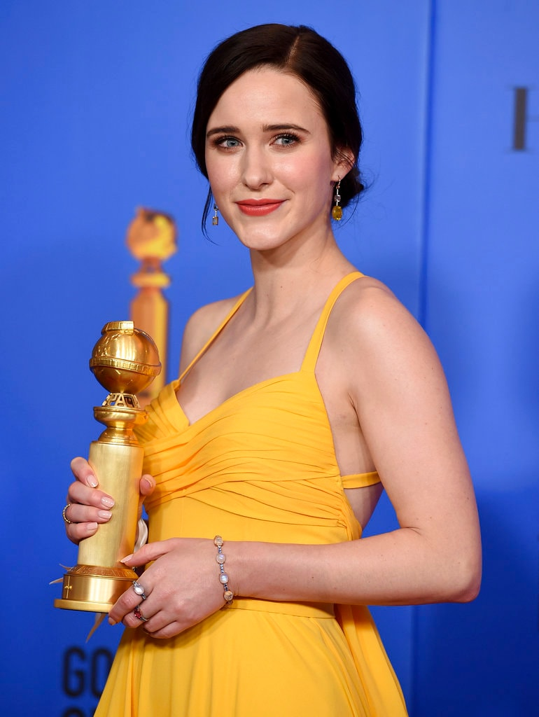 Rachel Brosnahan poses in the press room with the award for best performance by an actress in a television series, musical or comedy for