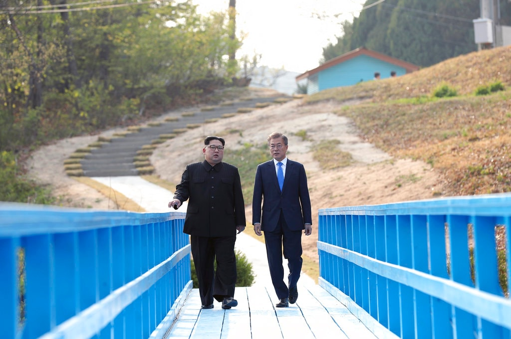 In this April 27, 2018, file photo, North Korean leader Kim Jong Un, left, and South Korean President Moon Jae-in talk as they walk on the blue bridge at the border village of Panmunjom in the Demilitarised Zone, South Korea. (Korea Summit Press Pool via AP)