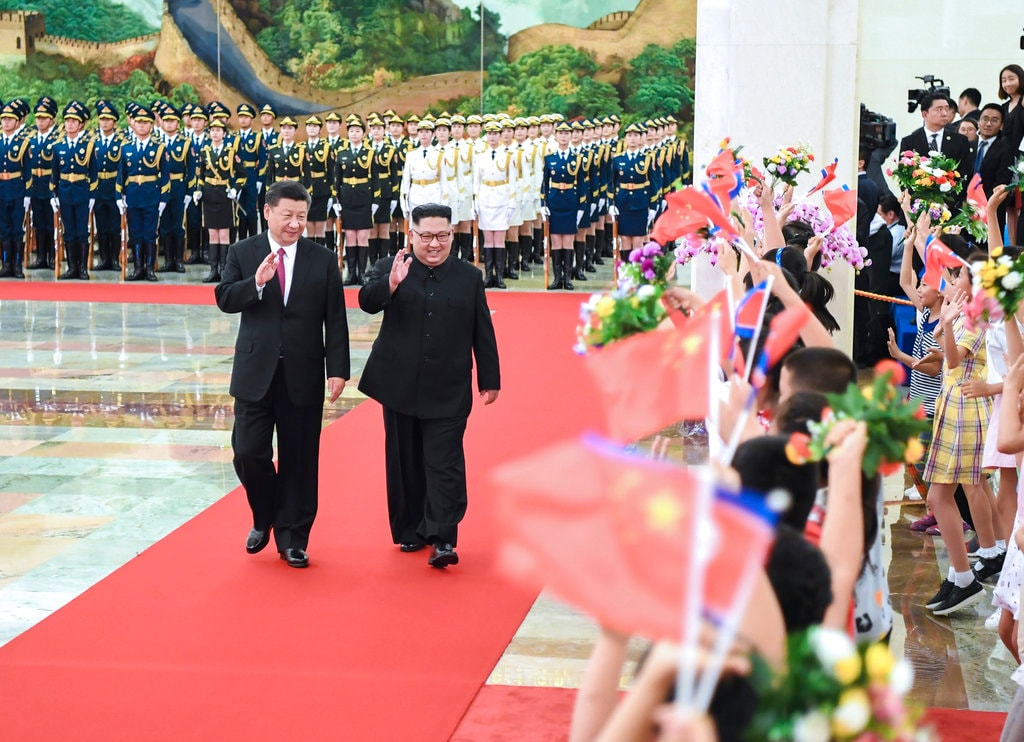 In this June 19, 2018, file photo provided by China's Xinhua News Agency, Chinese President Xi Jinping, left, and North Korean leader Kim Jong Un, right, walk together during a welcome ceremony for Kim at the Great Hall of the People in Beijing. (Shen Hong/Xinhua via AP, File)