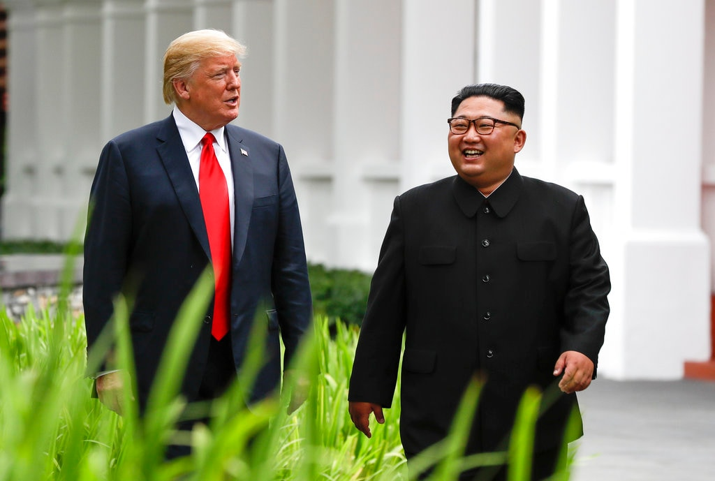 In this June 12, 2018, file photo, US President Donald Trump, left, and North Korea leader Kim Jong Un walk from their lunch at the Capella resort on Sentosa Island in Singapore. The most sensational of Kim's trip was the summit in Singapore with Trump. (AP Photo/Evan Vucci, File)