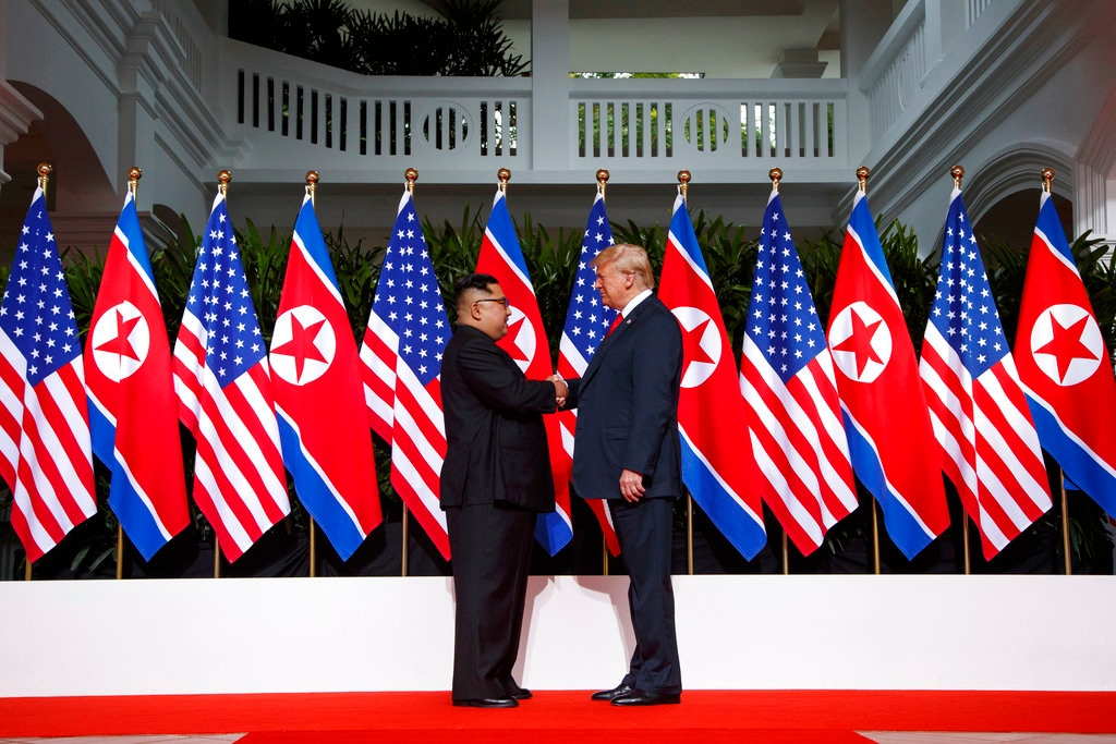 In this June 12, 2018, file photo, US President Donald Trump, right, shakes hands as he meets with North Korean leader Kim Jong Un on Sentosa Island, in Singapore. (AP Photo/Evan Vucci, File)