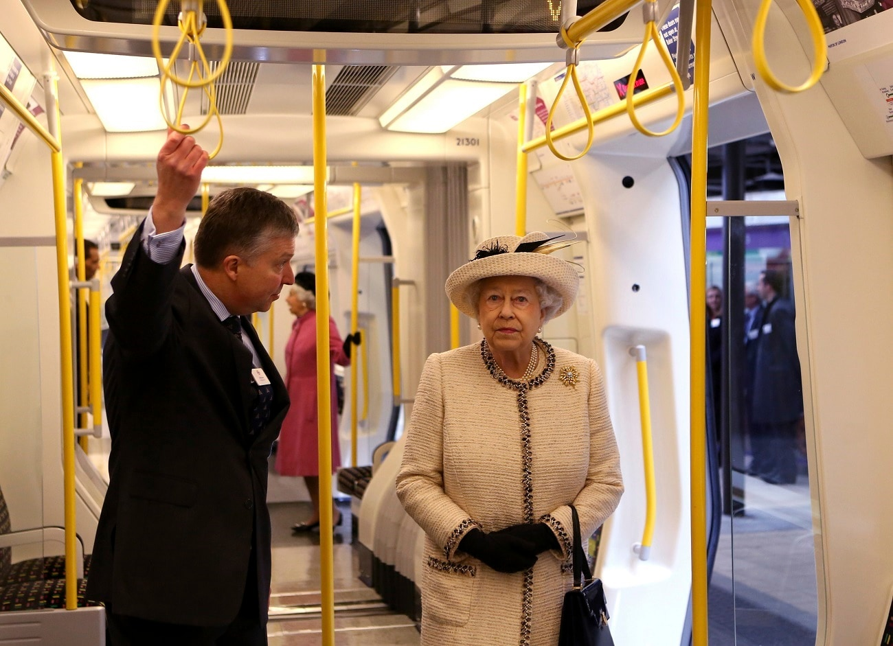 Queen Elizabeth II is given a tour of the carriage of a parked train at the Baker Street underground station in London, for a visit to mark the 150th anniversary of the London Underground. (AP Photo/Chris Radburn, Pool)