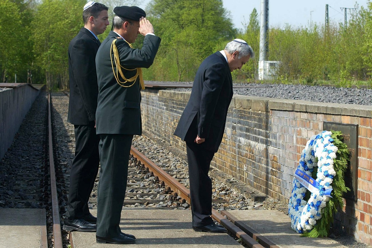 Israeli President Moshe Katsav, right, participates in a memorial ceremony to honor the Jews who were deported from Germany during the Nazi era, at Berlin-Grunewald's train track 17 in Berlin. (AP Photo/Franka Bruns)
