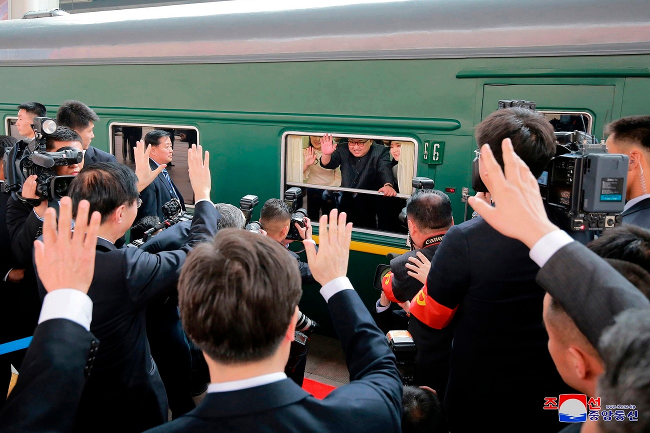 North Korean government, leader Kim Jong Un, center, waves as he was given a send-off at a train station in Beijing. (Korean Central News Agency/Korea News Service via AP, File)