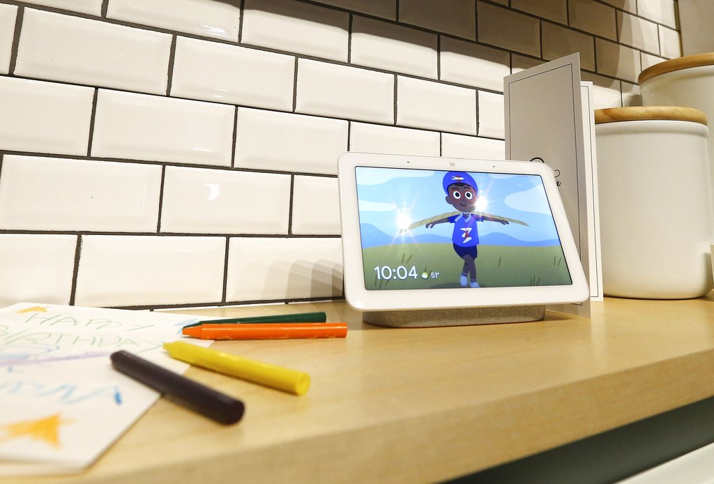 A Google Home Hub is displayed at the Google Assistant ride to show off the new features in its voice-enabled digital assistant as visitors ride along at the Google display area at CES International in Las Vegas.(AP Photo/Ross D. Franklin).