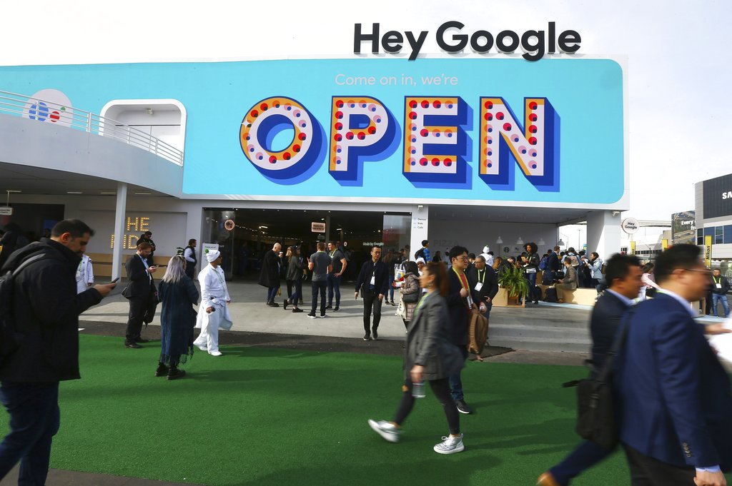 People walk past the Google building at CES International in Las Vegas. (AP Photo/Ross D. Franklin).