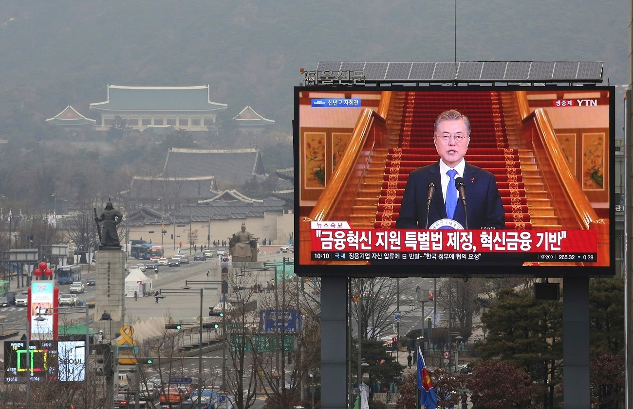 A TV screen shows the live broadcast of South Korean President Moon Jae-in's press conference in Seoul, South Korea. Moon has suggested he'll push for sanction exemptions to restart dormant economic cooperation projects with North Korea. (AP Photo/Ahn Young-joon, File)
