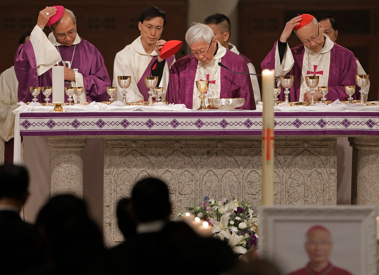 Bishop Joseph Ha, Cardinal Joseph Zen and Cardinal John Tong attend a vigil Mass for Bishop Michael Yeung in Hong Kong. Hong Kong Catholics mourned the loss of their bishop with a Mass on Thursday night amid a low-key struggle among clergy over reconciliation between the Vatican and Beijing.  (AP Photo/Vincent Yu, File)