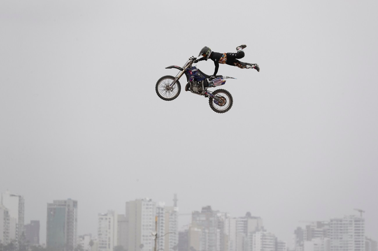 A rider performs a stunt prior to the podium ceremony before the start of the Dakar Rally in Lima, Peru.  (AP Photo/Martin Mejia)