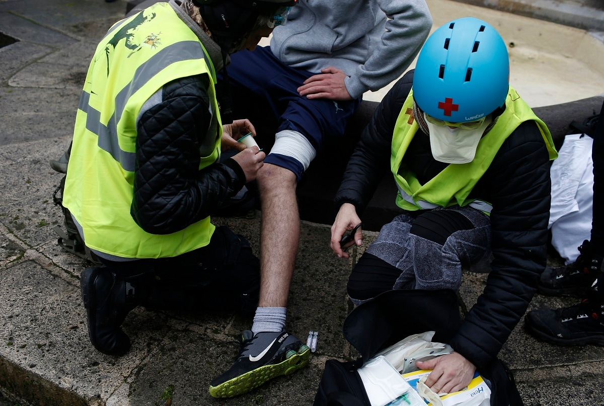 A protester hit by a flash-ball is treated during a yellow vest demonstration in Bourges. (AP Photo/Rafael Yaghobzadeh)