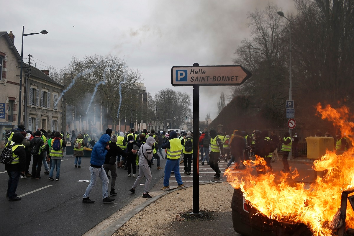 French police fires tear gas during a yellow vest demonstration in Bourges. (AP Photo/Rafael Yaghobzadeh)