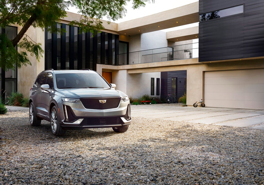 In this photo provided by Cadillac is the first-ever 2020 Cadillac XT6. Cadillac will show off its XT6, a smaller-than-a-truck, three-row family hauler at an event Sunday night, January 13, 2019. (Robert Kerian/Cadillac via AP)