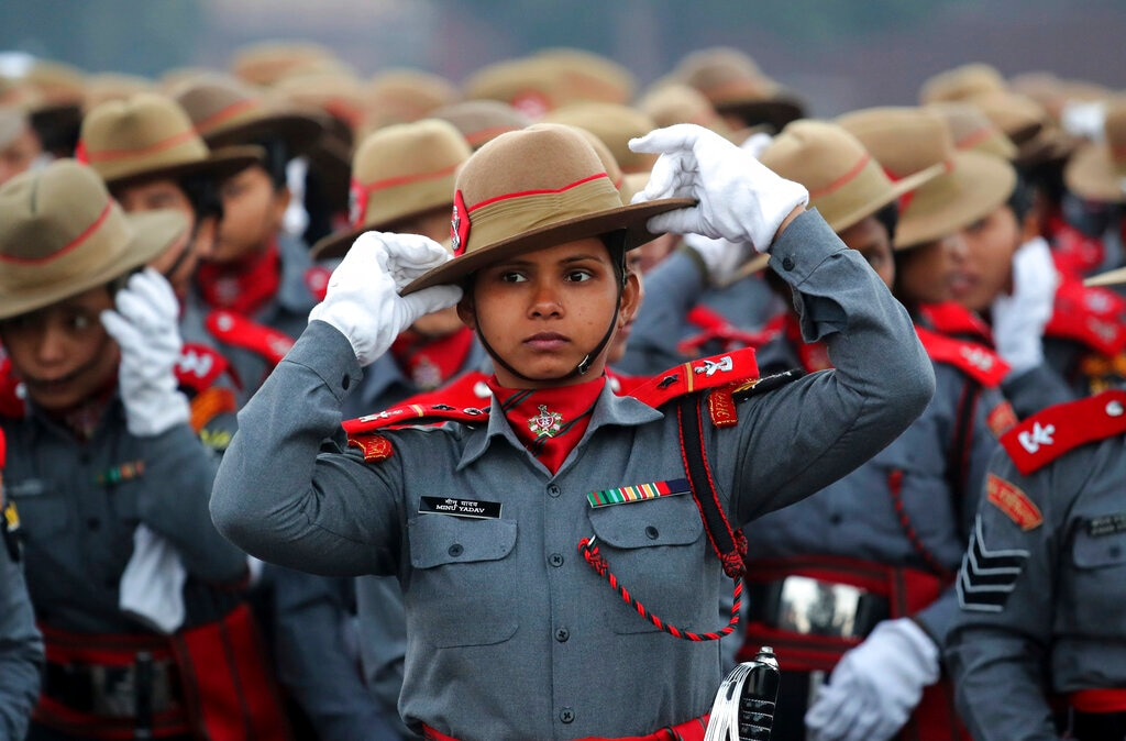 Indian Para-military women soldiers of Assam Rifles adjust their hats during the rehearsals for the upcoming Republic Day parade on Rajpath, the ceremonial boulevard, in New Delhi on January 14. (AP Photo/Manish Swarup)