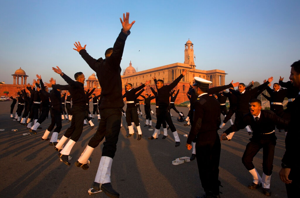 Indian Naval soldiers warm up during the rehearsals for the upcoming Republic Day parade at the Raisina hills, the government seat of power, in New Delhi on January 14. (AP Photo/Manish Swarup)