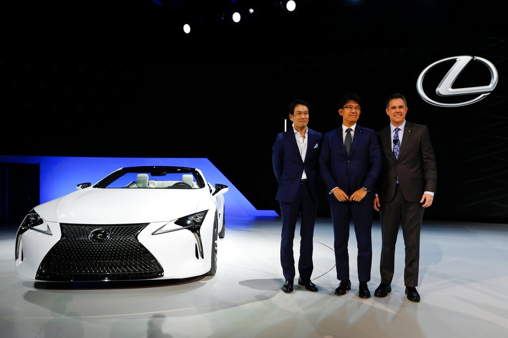 Tadao Mori, Chief Engineer, Lexus LC and RC F, from left, Koji Sato, Executive Vice President, Lexus International and David Christ, Group Vice President and General Manager, Lexus Division pose with the Lexus LC Convertible concept debuts during media previews for the North American International Auto Show in Detroit, Monday, January 14, 2019. (AP Photo/Paul Sancya)