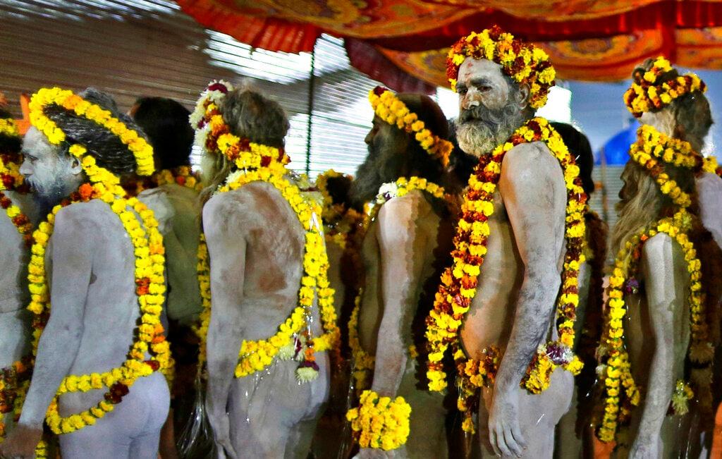 Naga Sadhus leave their camp for ritualistic dip on auspicious Makar Sankranti day during the Kumbh Mela, or pitcher festival in Prayagraj, Uttar Pradesh state, India, Tuesday, January 15, 2019. (AP Photo/Rajesh Kumar Singh)