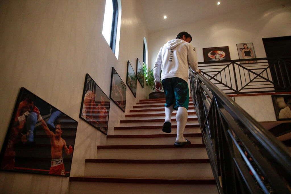 Boxer Manny Pacquiao walks up the steps to his bedroom for a nap following his morning run Monday, Jan. 14, 2019, in Los Angeles. The Filipino legend is in the winter of his career, gearing up for what could be one big last fight. Saturday's bout versus Broner isn't it, but Pacquiao trains with the knowledge that a second megafight against Floyd Mayweather could possibly be just months away if all goes well.
