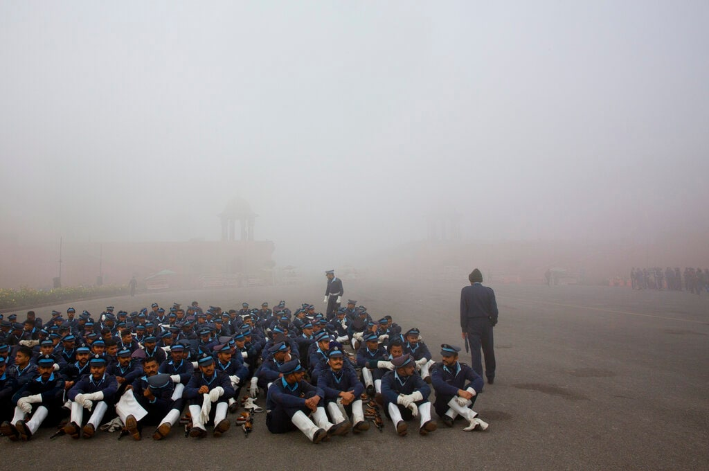Indian Air Force soldiers rest during the rehearsals for the upcoming Republic Day parade amidst morning fog in New Delhi on January 18. (AP Photo/Manish Swarup)