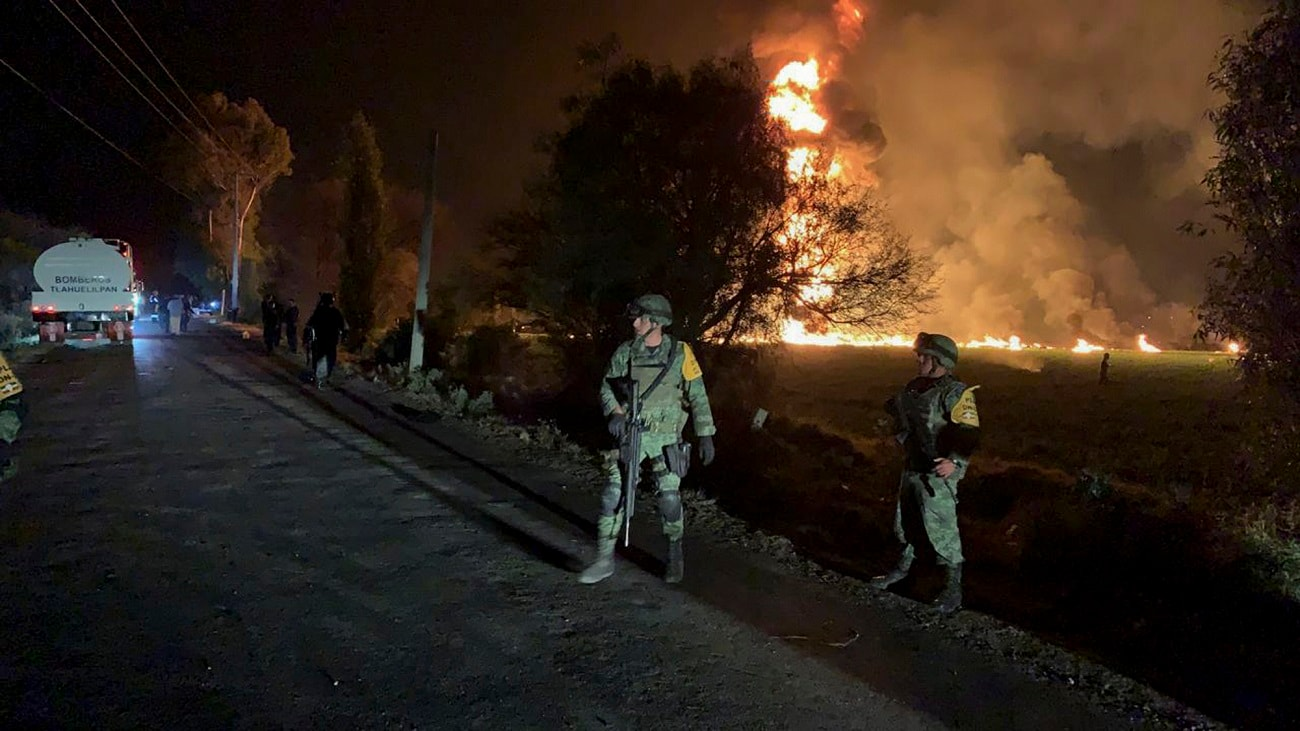 Soldiers guard in the area near an oil pipeline explosion in Tlahuelilpan, Hidalgo state, Mexico. (Secretary of National Defense via AP)