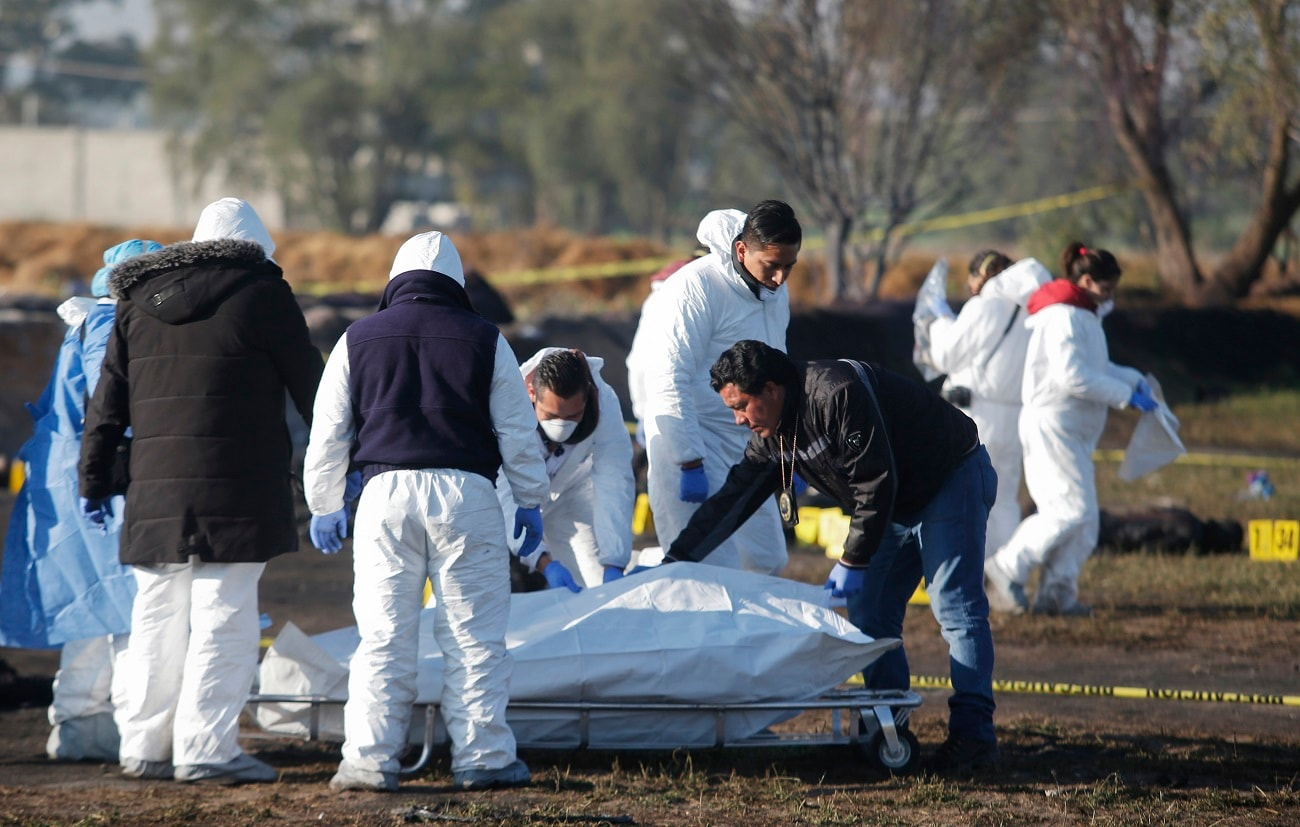 Forensic experts working in the explosion site. (AP Photo/Claudio Cruz)