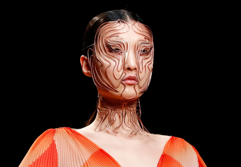A model wears a creation for Iris van Herpen's Spring/Summer 2019 Haute Couture fashion collection presented in Paris, Monday Jan.21, 2019. (AP Photo/Thibault Camus)