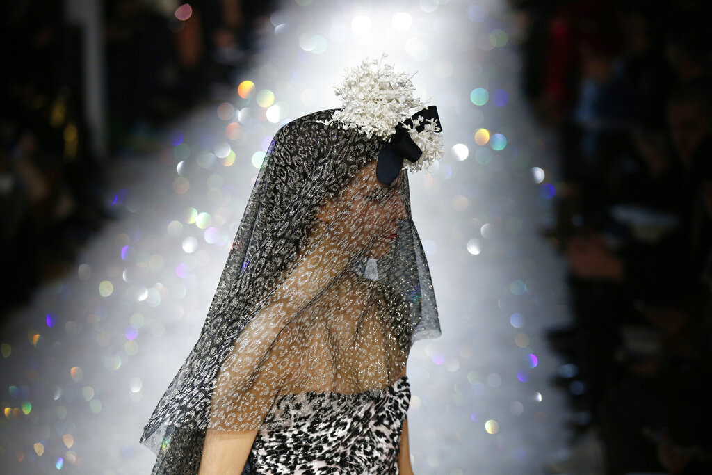 A model wears a creation for the Giambattista Valli Spring/Summer 2019 Haute Couture fashion collection presented in Paris, Monday Jan. 21, 2019. (AP Photo/Michel Euler)