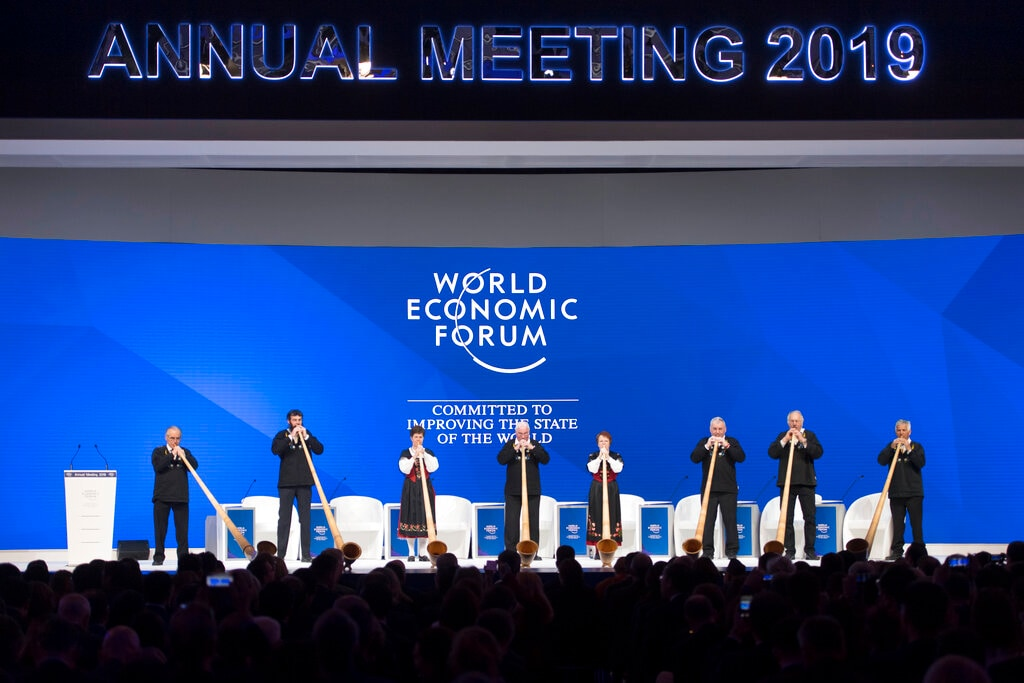 Alphorn players perform on stage before the opening session in the Congress Hall during the annual meeting of the World Economic Forum in Davos, Switzerland, Tuesday, Jan. 22, 2019. (Laurent Gillieron/Keystone via AP)