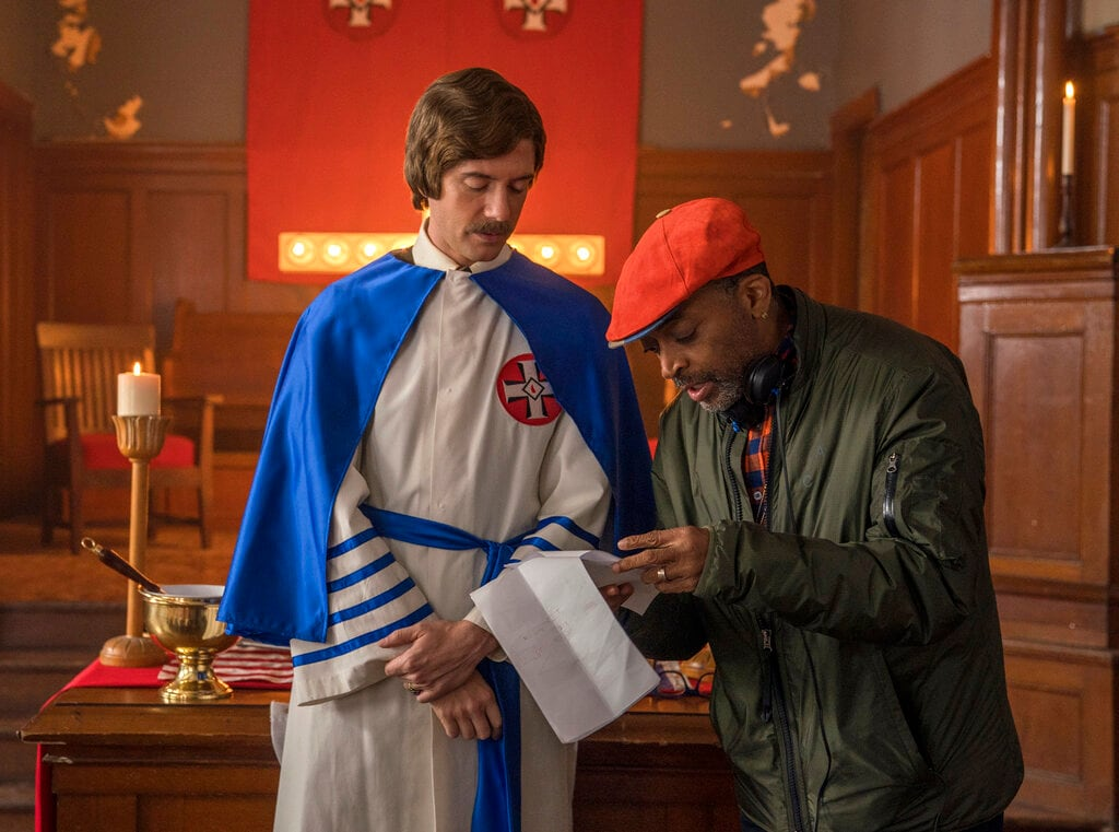 This image released by Focus features shows Topher Grace, left, with director Spike Lee on the set of