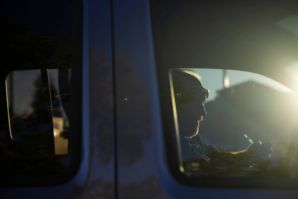 Chris George, a federal employee furloughed from his job as a forestry technician supervisor for the US Department of Agriculture Forest Service, makes a phone call in his pickup truck to set up an interview for a job as a driving instructor Monday, January 21, 2019, in Redlands, California. The 48-year-old Army veteran and federal employee has been working as a handyman and driving for Lyft to make ends meet since the government shutdown began. (AP Photo/Jae C. Hong)