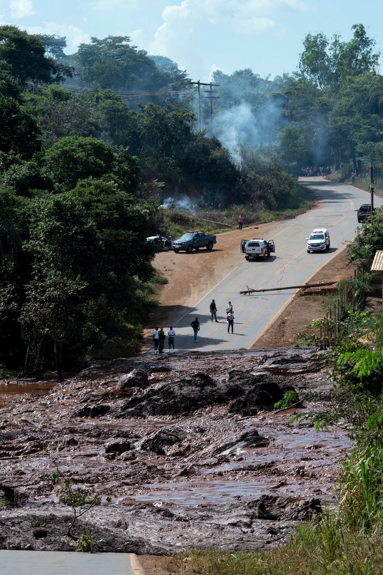 A road is blocked after a dam collapsed near Brumadinho, Brazil. (Leo Drumond/Nitro via AP)