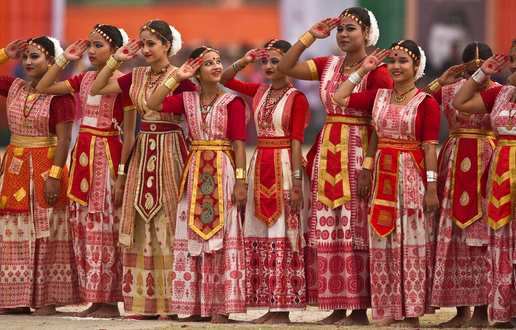 Dancers in traditional Assamese attire salute during a parade to mark Republic Day in Guwahati, India, Saturday, January 26, 2019. (AP Photo/Anupam Nath)