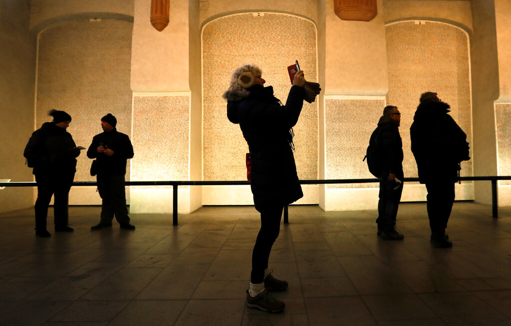 Tourists visit the Pinkas synagogue in Prague, Czech Republic, Thursday, January 24, 2019. (AP Photo/Petr David Josek)